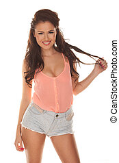 Happy relaxed young woman in skimpy shorts