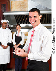 happy restaurant manager - young happy male restaurant...