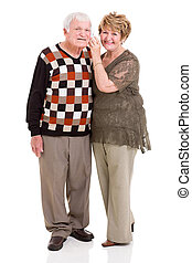 retired couple using mobile phone