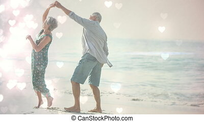 Happy retired elders dancing on the beach with hearts animation for valentine day