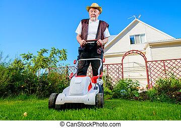 man mows a lawn
