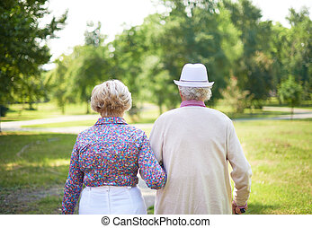 Happy retirement - Back view of serene senior couple taking...