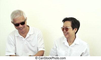 happy rich asian senior cash money