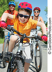Happy ride - Portrait of happy boy riding bicycle in the ...