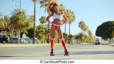 Happy Roller Skate Girl Standing on the Street of Costa del...