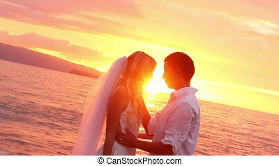 happy romantic bride and groom, sunset wedding on tropical beach, hd video