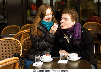 Happy romantic couple in a Parisian street cafe