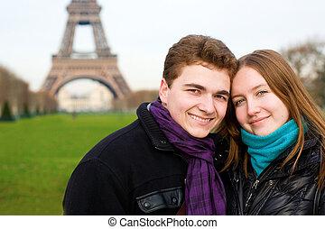 Happy romantic couple in Paris near the Eiffel Tower