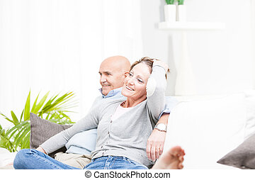 Happy romantic couple watching television