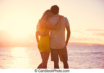 Romantic Couple Watching the Sunset on Tropical Beach - ...