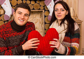 Happy romantic couple with a red heart