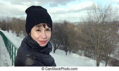 Happy Romantic Girl Looking and taking at Camera in Snowy...