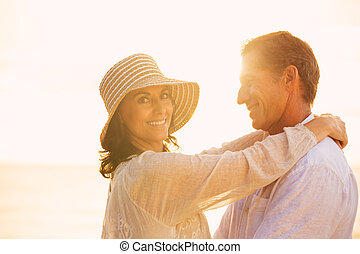 Mature Couple in Love on the Beach at Sunset