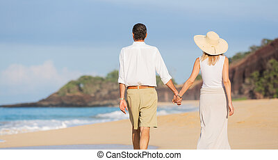 Middle Aged Couple Enjoying Walk on the Beach