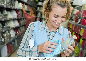 happy sales assistant in beauty product shop