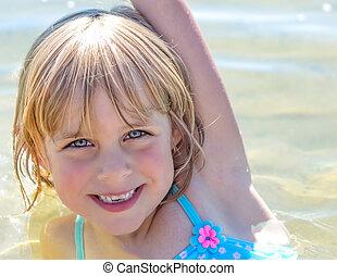 Happy, Sandy Little Girl in the Lake