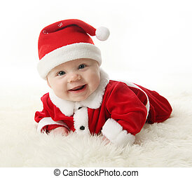 Happy Santa Baby - Happy Smiling baby lying on tummy wearing...