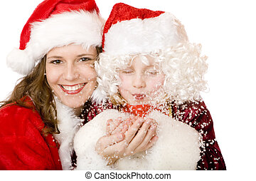 Happy Santa Claus Woman and child blowing Christmas snow