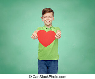 happy school boy holding red heart shape