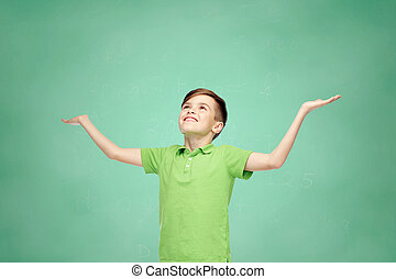 happy school boy in polo t-shirt raising hands up - ...