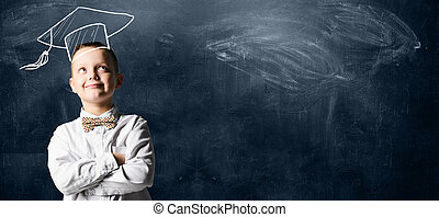 Happy school boy - School boy standing against blackboard