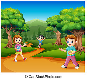 Happy school children in the forest