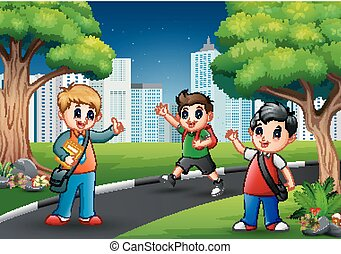Happy school children walking on the road to the city
