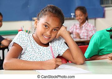 Happy school girl in class