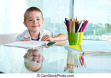 Happy schoolboy - Happy schoolkid looking at camera with ...