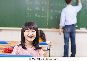 happy schoolchildren looking at camera