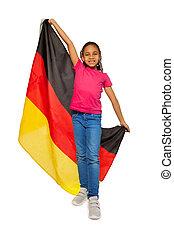 Happy schoolgirl holding big German banner