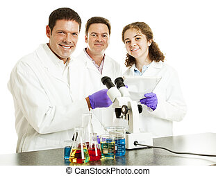 Happy Scientists in Lab - Three happy scientists in their...