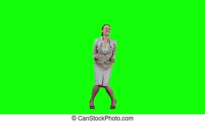 Happy secretary in slow motion raising her arms