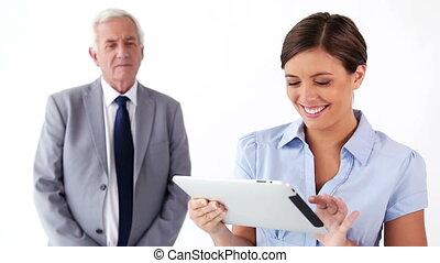 Happy secretary using a tablet computer