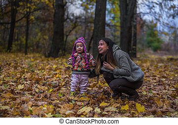 small child with my mother, autumn concept
