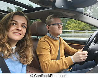 Happy selfie photo in modern car during vacation