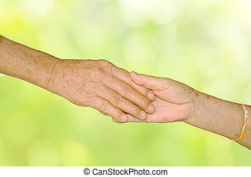 Happy Senior Adult Couple Holding Hands together on green nature