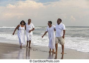 Happy Senior African American Couples Men Women on Beach