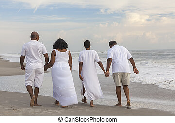 Happy Senior African American Couples Men Women on Beach