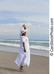 Happy Senior African American Woman Dancing on Beach