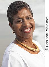 Happy Senior African American Woman on Beach
