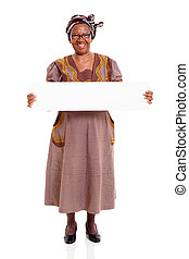 senior african woman holding white board