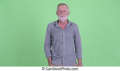 Happy senior bearded man smiling - Studio shot of handsome...