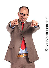 happy senior businessman pointing fingers