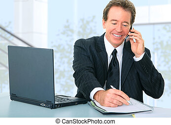 Happy Senior Businessman Working In Office