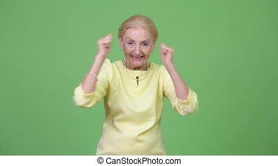 Happy senior businesswoman looking excited