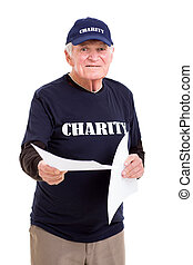 senior charity worker handing out papers