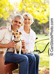 senior couple and pet dog - happy senior couple and pet dog...