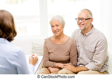 happy senior couple at home - family, relations, age and...