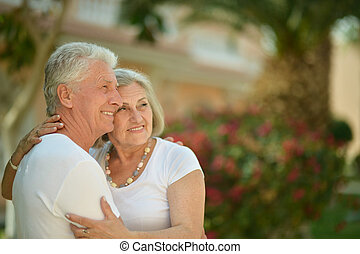 couple at tropic hotel - happy senior couple at tropic hotel...
